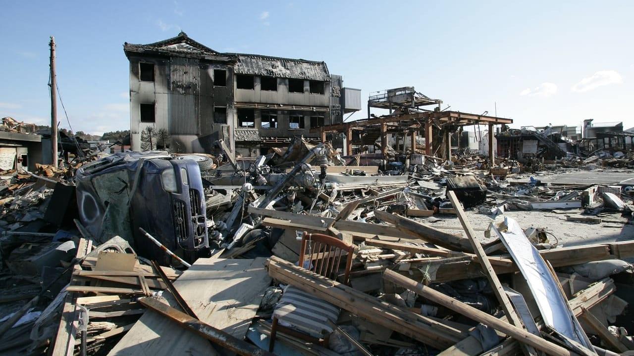 地震で倒壊した家